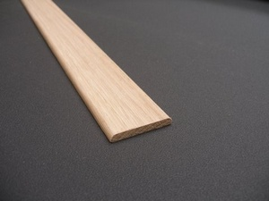 SOLID OAK COVER STRIP 22X6 SOLID OAK SINGLE PENCIL ROUNDED ONE SIDE.